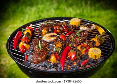 Top view of fresh meat and vegetable on grill