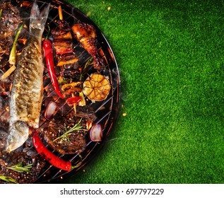 Top view of fresh meat and vegetable on grill placed on grass. Barbecue, grill and food concept