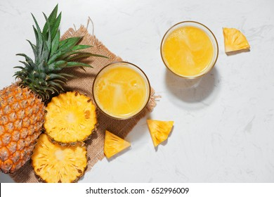 Top view of fresh pineapple juice in the glass with pineapple fruit