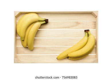 top view of fresh ripe bananas on wooden tray isolated on white