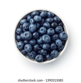Top view of fresh ripe blueberries in bowl isolated on white