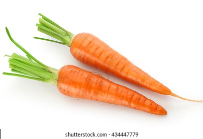 Top view of fresh whole carrots on the white background
