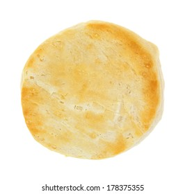 Top view of a freshly baked buttermilk biscuit on a white background.