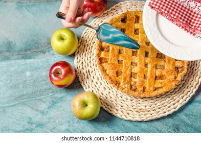 Top view freshly made apple pie , top view, red and green apples on marble table setting