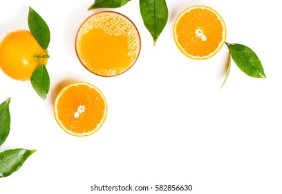 Top view of freshly squeezed juice with orange fruits with green leaves isolated on white background.