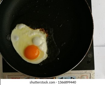 top view fried egg is cooking, omelette is cooking on frying pan. fresh egg.