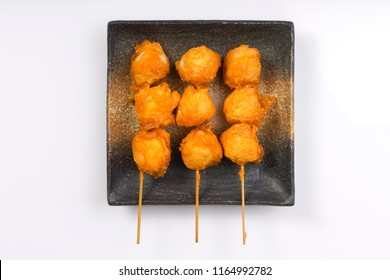 Top view fried fishball with skewer  in square dish on white background, This food is street food in Thailand