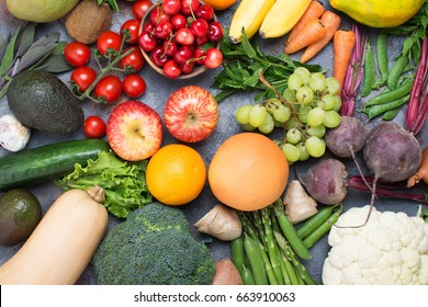 Top view of fruits and vegetables in a circle, cherries, apples, kiwis, bananas, oranges, avocados, carrots, beetroot, cauliflower, broccoli, cucumber, copy space, top view, selective focus