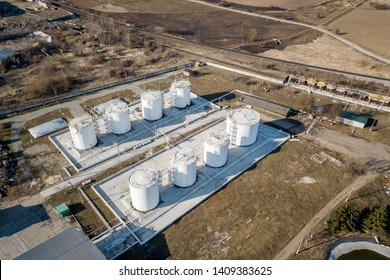 Top view of fuel oil refinery industrial factory. White cylindrical metal tanks containers.