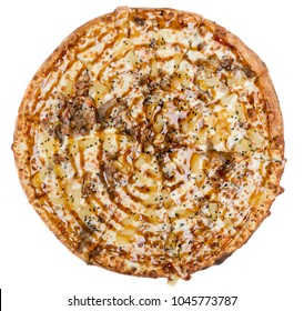 Top view of a full chicken pizza with teriyaki sauce and pineapple isolated on white.