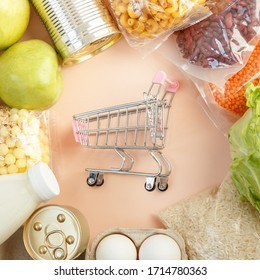 Top view full of food from the supermarket. Colorful composition of food. Shopping cart.