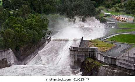 Top View Of The Full Force Of Water Overflowing At The Iconic Hinze Dam's Spillway After Cyclone Debbie During The Evening, Advancetown Lake, Gold Coast, Queensland, Australia