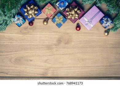 top view gift boxes and ball on the wood table with the holiday season.Festival christmas and snowflake