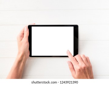 Top view of girl using tablet on white table background