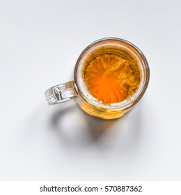Top view of a glass of beer closeup