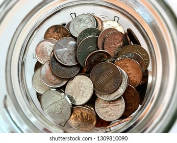 Top view of a glass jar of loose change
