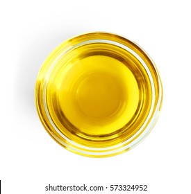Top view of glass with olive oil on white background