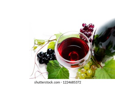 Top view of glass of red wine and bottle with grape vine isolated over white background. Wine tasting border design banner. Wine art shop and winery concept.