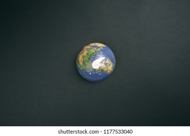 Top view of globe on black background