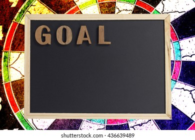 top view goal wood text on blackboard background,concept of goal setting