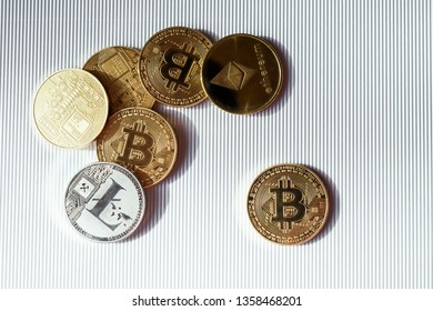 Top view of gold and silver coins with  bitcoin, lisk and ethereum symbol. Concept of finance and business in internet. Virtual crypto currency.