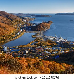 Top view in golden autumn of center of Petropavlovsk-Kamchatsky City, beautiful deep blue Avacha Bay and Pacific Ocean. Eurasia, Russian Far East, Kamchatka Peninsula.