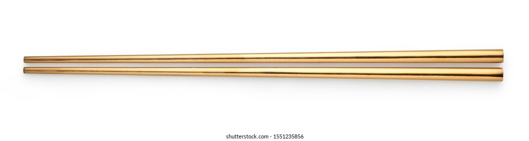 Top view of Golden chopsticks isolated on white background