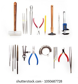 Top view of goldsmiths tools, jewelry objects. Tools over white background.