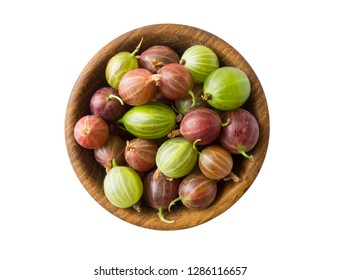 Top view. Gooseberries fruits on white background. Bowls with gooseberries isolated on white background. Red and green gooseberries in a bowl with copy space for text. Ripe gooseberry close-up.