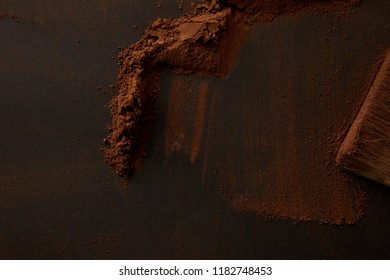 top view of gourmet cocoa powder on black background