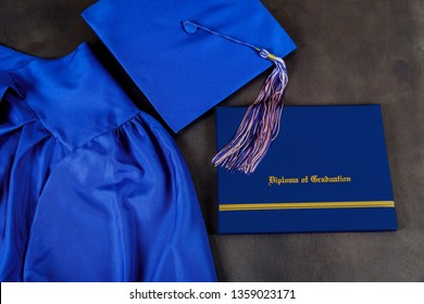 Top view of graduation cap, hat with degree paper certificate graduation on dark background, education concept