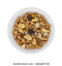 Top view of granola with freeze dried fruit in a bowl isolated on a white background.