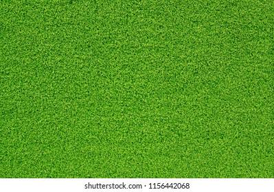 Top view green artificial grass texture background.