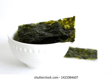 top view of green dried nori sheet isolated on white background. Copy space.Organic Green Dry Roasted Seaweed Sheets.