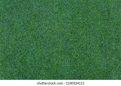 Top View Green Grass, Artificial Football Coverage, Field Or Lawn. Fake Grass Background For Playgrounds And Decoration.