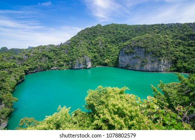 Top view of green lagoon with forest mountain and cloudy sky background. Mu Koh Angthong Nationnal Park, Koh Samui Thailand