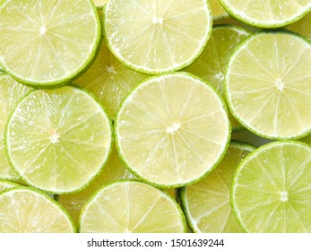 Top view of green lemon background, juicy slice of lime wallpaper.