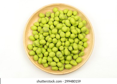 top view green peanut in wooden plate on white background