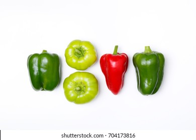 Top view of green pepper, red paprika on white background. Minimal concept. Vegan food.