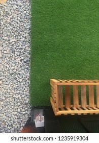 Top view to green plastic grass on floor. Exterior with artificial grass. Green turf cover on backyard