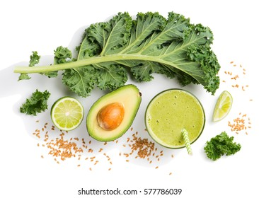 Top view of green smoothie from kale, avocado and seeds of flax isolated on white background.
