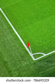 Top view of green soccer field.Beautiful grass on the stadium.Abstract football ground background with white stripe line and red flag on the corner.Background,Sport,Texture Concept.Anfield,Liverpool