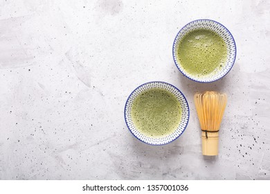 Top view of green tea matcha in a bowl on concrete surface. It is a rich source of antioxidants and polyphenols. When preparing, the powder is partially dissolved in hot water