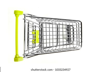 Top view of green trolley on studio, isolated on white background