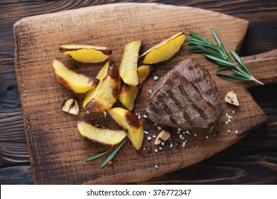 Top view of grilled beef fillet mignon steak with roasted potato