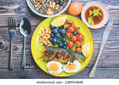 Top view grilled Saba fish steak and fruit combined - Japanese food style
