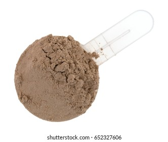 Top view of ground chocolate flavored plant protein in a plastic measuring scoop isolated on a white background.