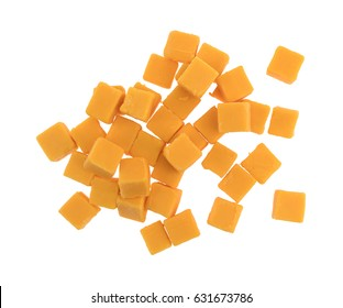 Top view of a group of cubed mild cheddar cheese pieces isolated on a white background.