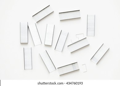 A top view of a group of staples on white background.