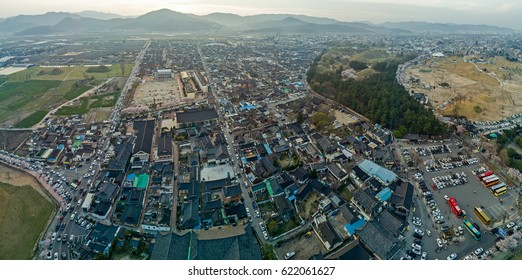 Top view of Gyeongju city in South korea. The scenery consist of mountain, many building and many car.